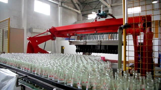 Shot of robotic arms moving beverage bottles /Xi'an, Shaanxi, China