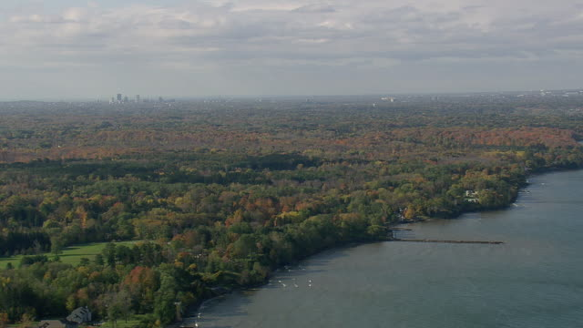 WS AERIAL Shot of Rochester city from Lake Ontario shoreline / New York, United States