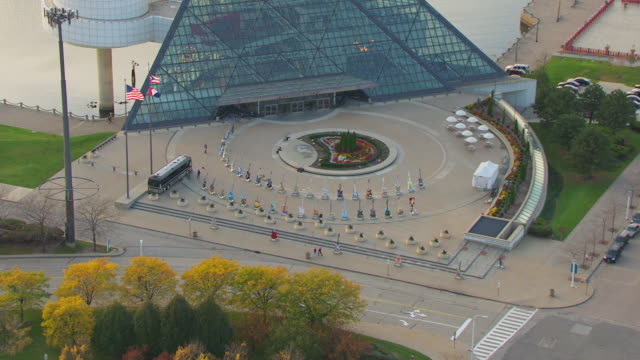 ws zi aerial shot of rock and roll hall of fame museum building and guitars on display in outdoor plaza / cleveland, ohio, united states - cleveland ohio stock videos and b-roll footage