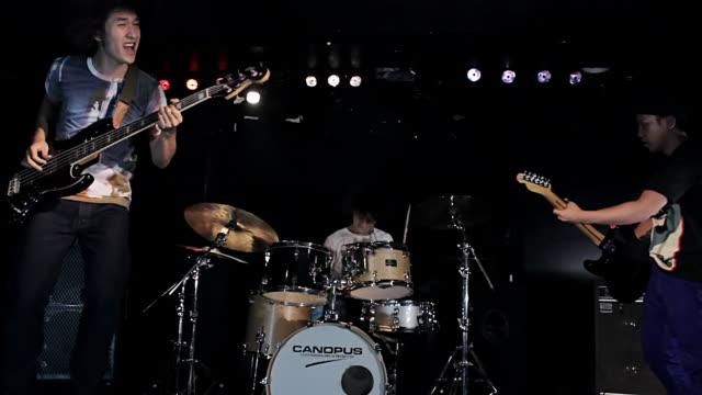 ms pan shot of rock band performing / shinjuku, tokyo, japan - bass guitar stock videos & royalty-free footage