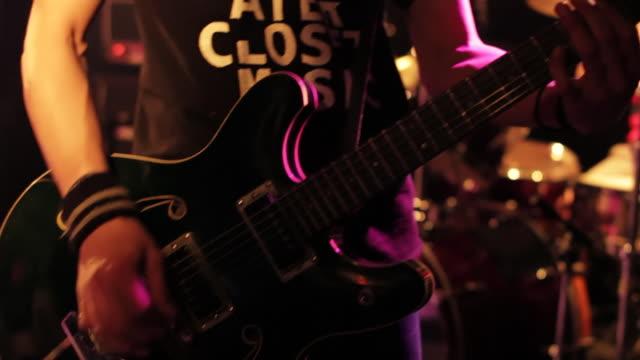 MS TD Shot of rock band playing on stage / Shimokitazawa, Tokyo, Japan