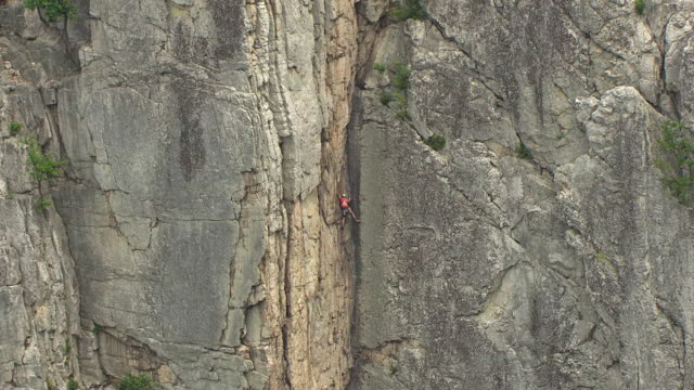 MS ZO AERIAL Shot of rock climber and large rock wall at Seneca Rocks in Pendleton County / West Virginia, United States