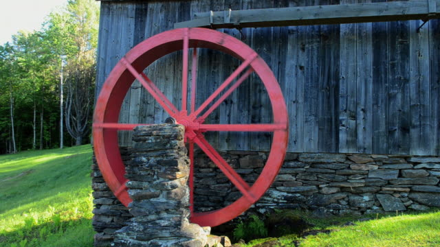 CU Shot of Rockingham Vermont old barn mill with paddle wheel red in woods / Rockingham, Vermont, United States