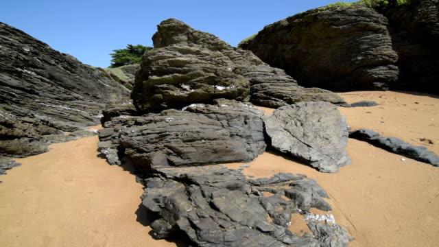 tu shot of rocky coast at cote de jade - 干潮点の映像素材/bロール