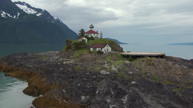 ms aerial tu shot of rocky terrain and eldred rock lighthouse / alaska, united states - juneau stock videos and b-roll footage