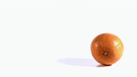 ms slo mo shot of rolling orange(citrus sinensis) / vieux pont, normandy, france - orange stock videos & royalty-free footage