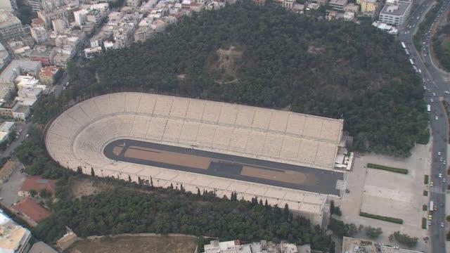 ws aerial zi shot of roman stadium / athens, greece - athens greece stock videos & royalty-free footage