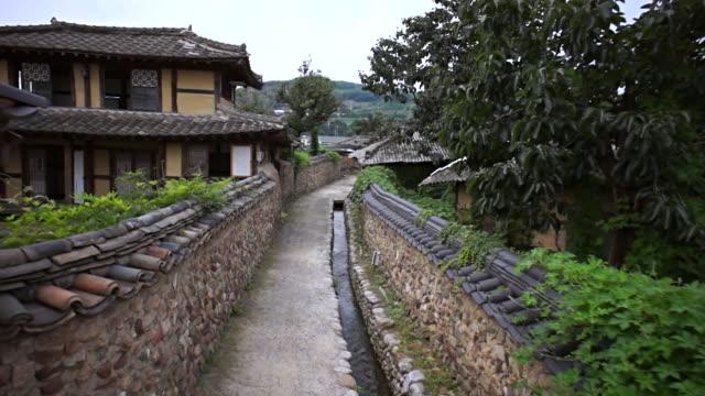 MS POV PAN Shot of Roof tile with Stone wall road at Changpyeong Slowcity / Damnyang, Jeollanamdo, South Korea
