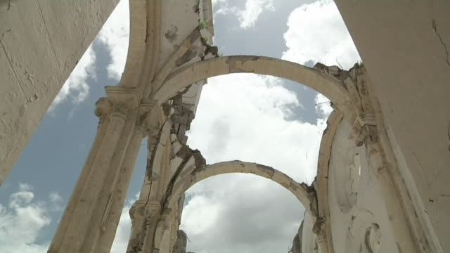 ms td tu shot of roof to nave of destroy cathedral of our lady of assumption / port-au-prince, haiti - arco architettura video stock e b–roll