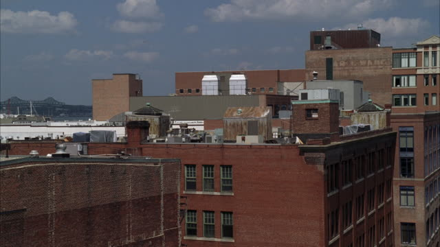 WS Shot of roof top of  older eastern multi-story building / Unspecified