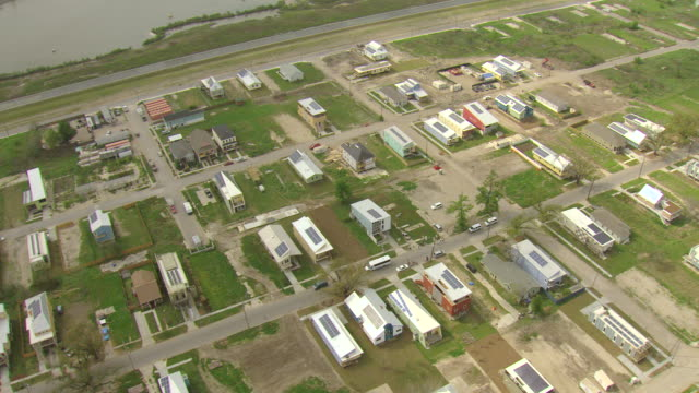 MS AERIAL Shot of roof tops of make it right houses in ninth ward / New Orleans, Louisiana, United States