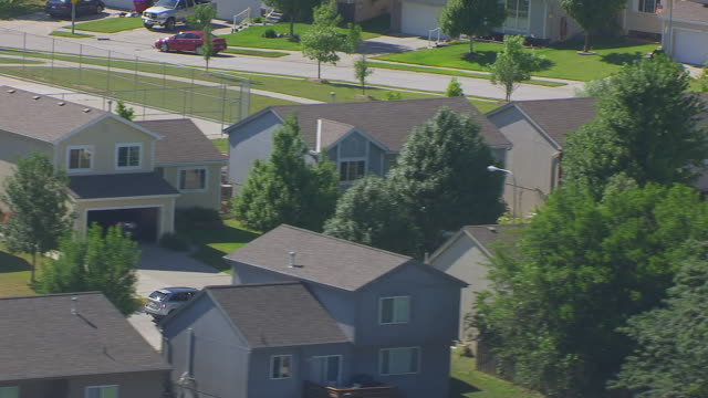 MS AERIAL Shot of Rooftops of homes on block in neighborhoods on outskirts of Omaha / Nebraska, United States