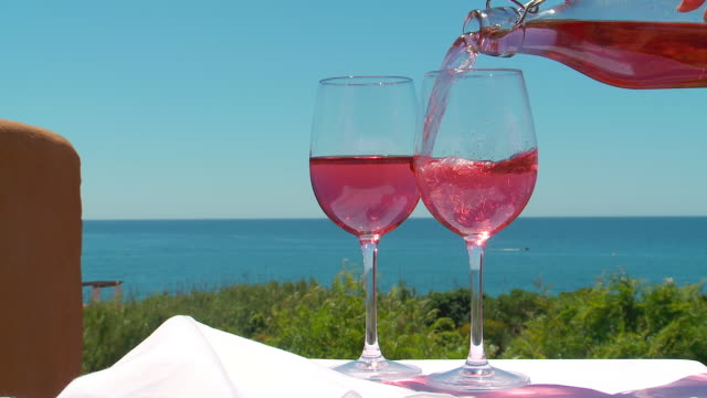 ms shot of rose wine pouring in glass / estepona, malaga, spain - rose wine stock videos and b-roll footage