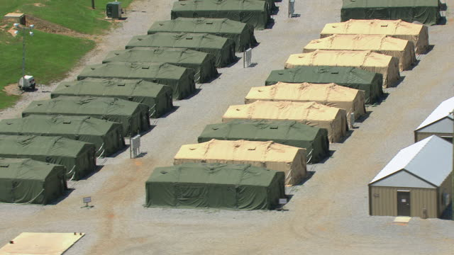 ms aerial zi shot of rows of army tents at camp shelby military post / mississippi, united states - military base stock videos & royalty-free footage
