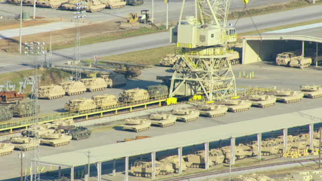 ms aerial tu shot of rows of tanks and crane at anniston army depot / alabama, united states - army stock videos & royalty-free footage