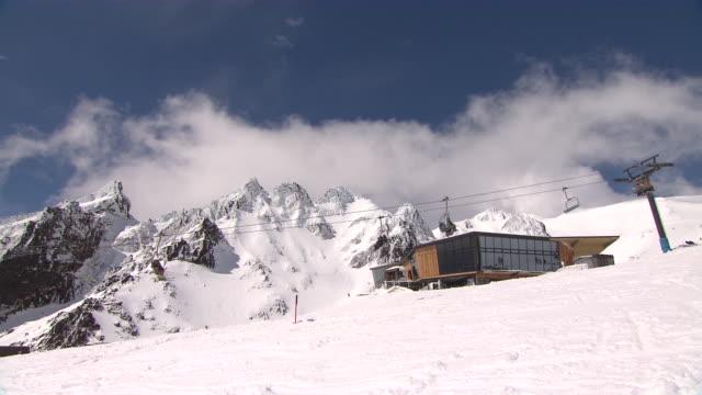 MS Shot of Ruapehu Ski Lodge with Chairlifts moving / Ruapehu, Manawatu, New Zealand