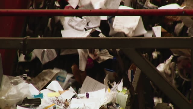 cu shot of rubbish being sorted by machine in recycling centre / london, united kingdom  - リサイクル工場点の映像素材/bロール