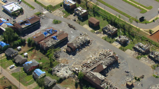ms aerial zi shot of rubble and ruins of tornado damaged homes / tuscaloosa, alabama, united states - 2011 stock videos & royalty-free footage