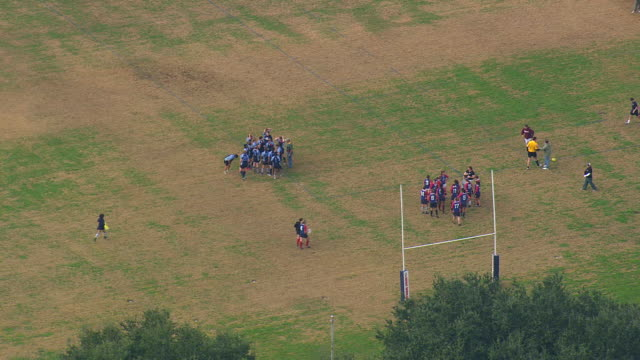 MS AERIAL Shot of rugby player playing at Citadel military college ground / South Carolina, United States