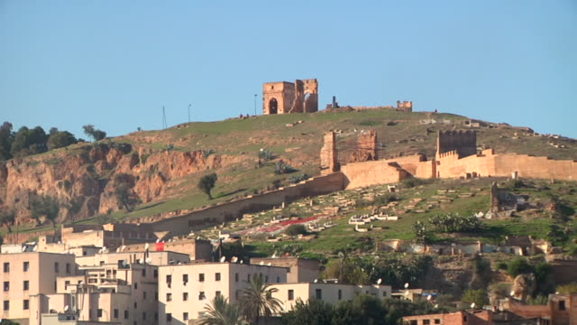 ws shot of ruined structure on top of hill / fes, centro-north, morocco - wiese video stock e b–roll