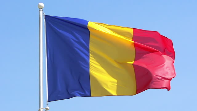 MS SLO MO Shot of Rumanian flag waving in wind / Caen, Normandy, France