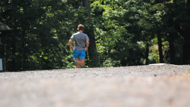 MS R/F Shot of Runner runs away / New Paltz, New York, United States