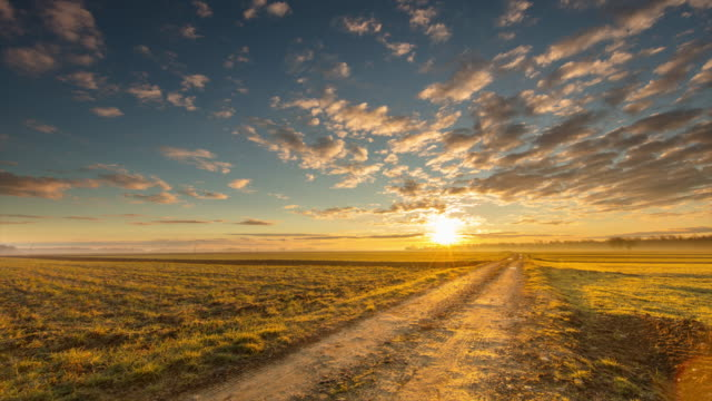 t/l 8k shot of rural fields in sunrise - fast motion stock videos & royalty-free footage