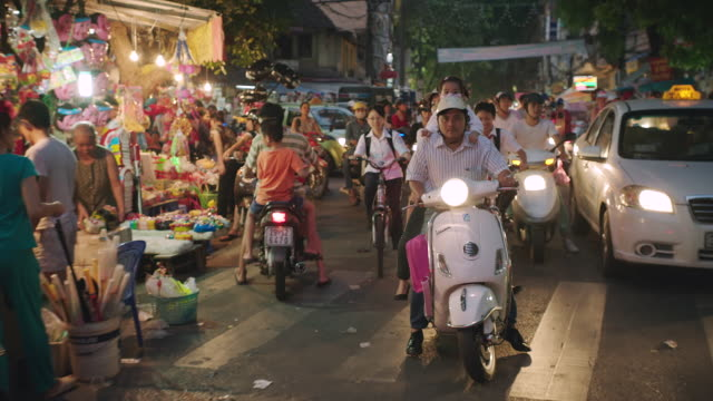 ms slo mo pov shot of rush hour in city / hanoi, vietnam - vietnam stock videos & royalty-free footage