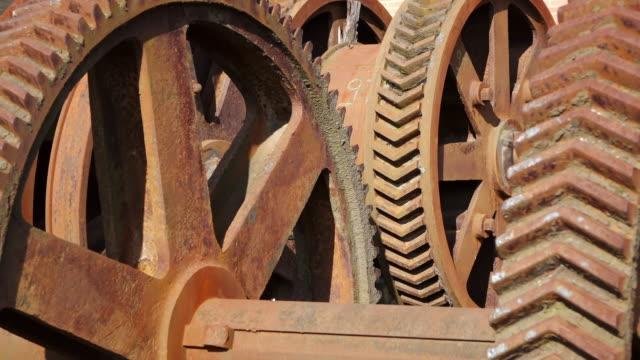 CU Shot of rusty iron wheels at Museum Les Mineurs Wendel / Petite Rosselle, Lorraine, France