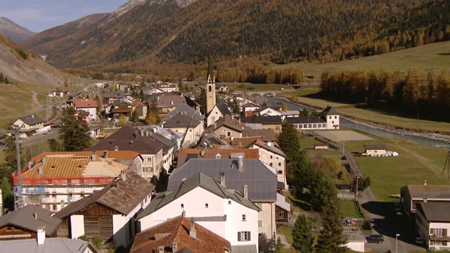 ms aerial shot of s chanf and inn river / s chanf, upper engadin, switzerland - inn river stock videos and b-roll footage