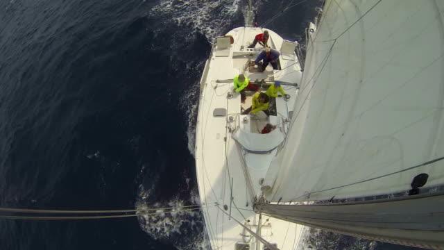 vídeos y material grabado en eventos de stock de ms shot of sailboat from top of mast with people / south korea - velero
