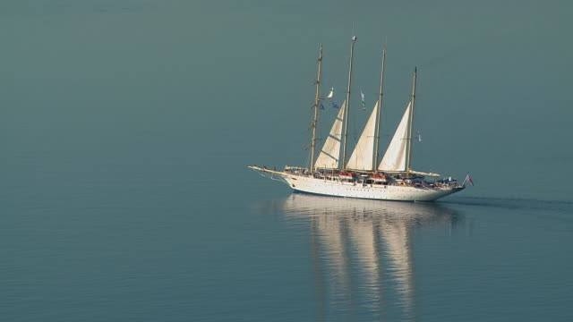 MS Shot of sailing ship moving in Ocean / Santorini, Cyclades, Greece
