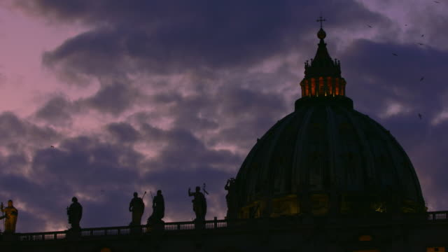 t/l shot of saint peter's cupola at sunset - video stock - catholicism stock videos & royalty-free footage