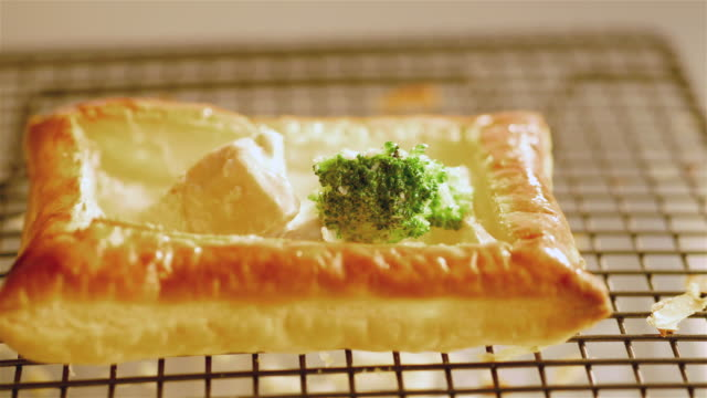cu pan shot of salmon and vegetable mix being spooned into pastry case / newport, south wales, united kingdom - wales stock videos & royalty-free footage