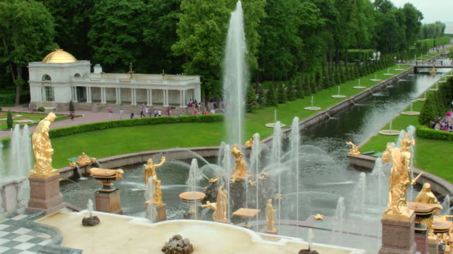 MS Shot of samson fountain with Sea Channel and tourist walking in Peterhof palace Summer Garden / St. Petersburg, Russia