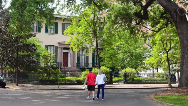 MS Shot of savannah Georgia street scene withand old homes and couple walking / Savannah, Georgia, United States