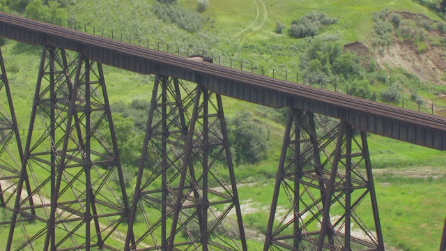 CU AERIAL TS ZO Shot of Scaffolding and pull out to Gasman Coulee Railroad Trestle / Minot, North Dakota, United States