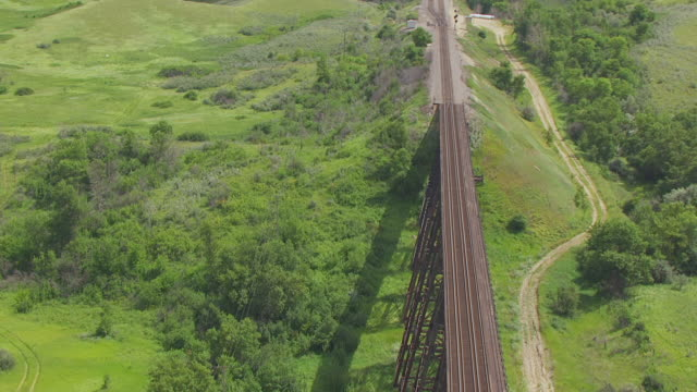 CU AERIAL TU Shot of Scaffolding and pull out to train track at Gassman Coulee Railroad Trestle / Minot, North Dakota, United States