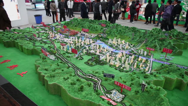 ms shot of scale model of baoji city in consulting meeting for investment / xi'an, shaanxi, china - architectural model stock videos & royalty-free footage