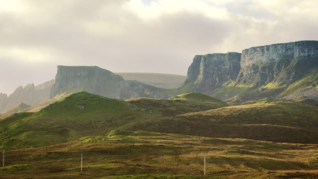 WS PANS Shot of scottish mountains with sun and clouds / Skye Island, Scotland, United Kingdom