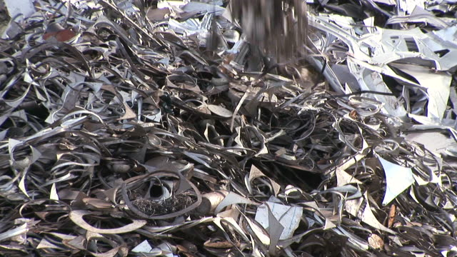 ms shot of scrap depot at steel mill / bous, saarland, germany - metall bildbanksvideor och videomaterial från bakom kulisserna