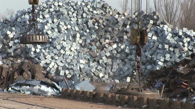 ms shot of scrap depot at steel mill / bous, saarland, germany - steel stock videos & royalty-free footage