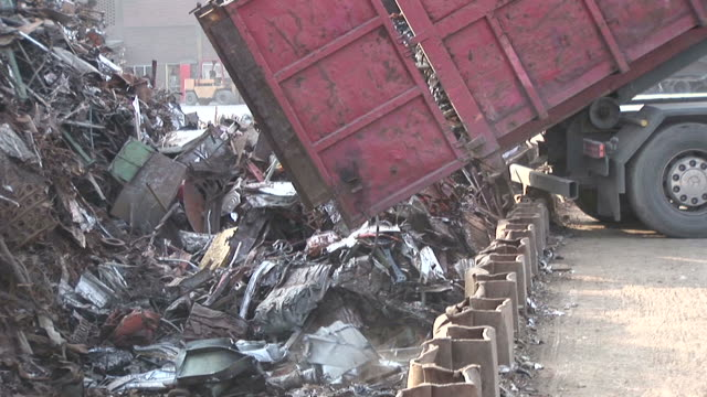 ms shot of scrap unloading in scrap depot at steel mill / bous, saarland, germany - dump truck stock videos and b-roll footage