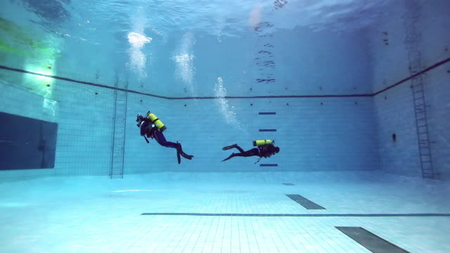 ms shot of scuba divers swimming underwater in swimming pool / seoul, south korea  - goggles sportswear stock videos and b-roll footage