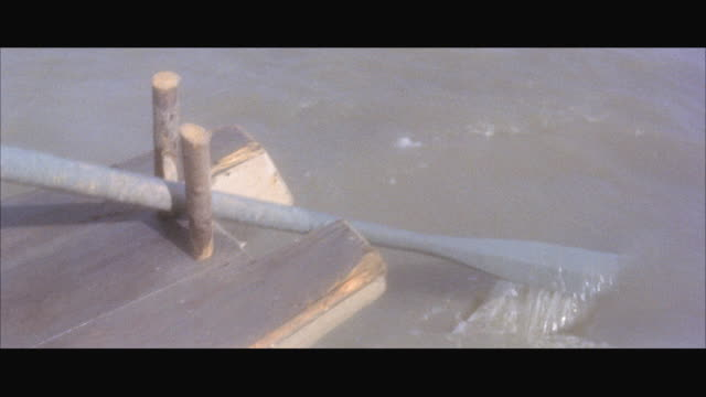 cu pov shot of sculling  sampan oar / hong kong - sampan stock videos & royalty-free footage