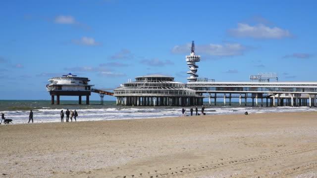 ms shot of sea bath scheveningen, beach and promenade / den haag, south holland, netherlands - south holland stock videos and b-roll footage