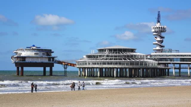 ws shot of sea bath scheveningen, beach and promenade / den haag, south holland, netherlands - south holland stock videos and b-roll footage