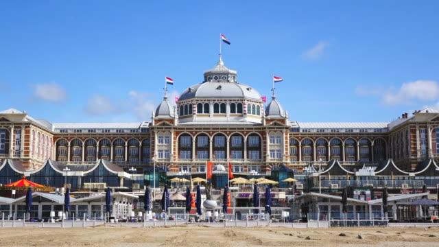 ws shot of sea bath scheveningen, promenade and kurhaus / den haag, south holland, netherlands - netherlands stock videos & royalty-free footage