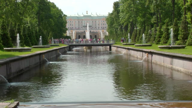 MS Shot of sea Channel with trees in Peterhof palace Summer Garden / St. Petersburg, Russia