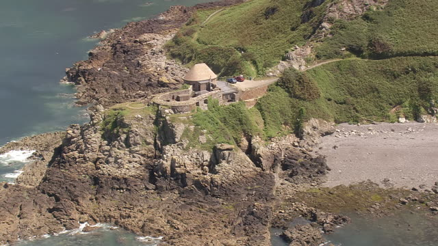ws aerial zi shot of sea coast / guernsey, channel isles - guernsey stock videos & royalty-free footage